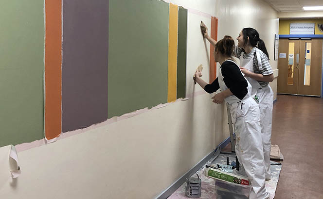 Students helped with installation of the paintings