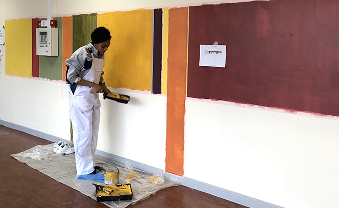 Students helped with the installation of the paintings