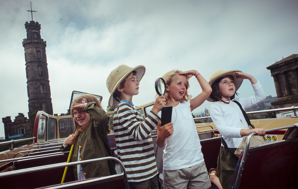 Children on an Edinburgh tour bus playing with the Treasure Trapper app