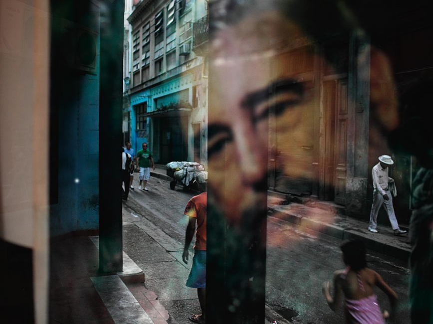 Fidel Castro reflected in window in Havana, Cuba