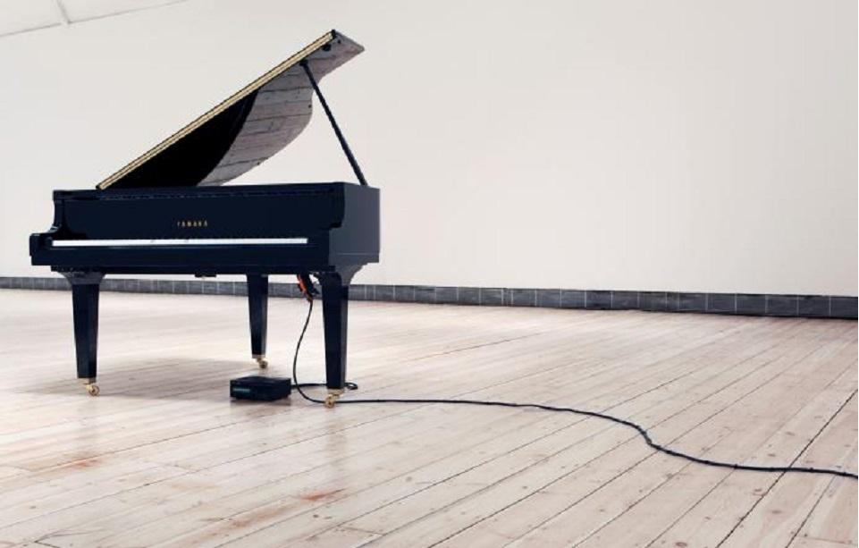 Photo credit - Katie Paterson, Earth–Moon–Earth (Moonlight Sonata Reflected from the Surface of the Moon, 2007, Disklavier grand piano, Installation view, Cornerhouse, Manchester 2011 Photo © We are Tape Courtesy of the artist and Ingleby, Edinburgh