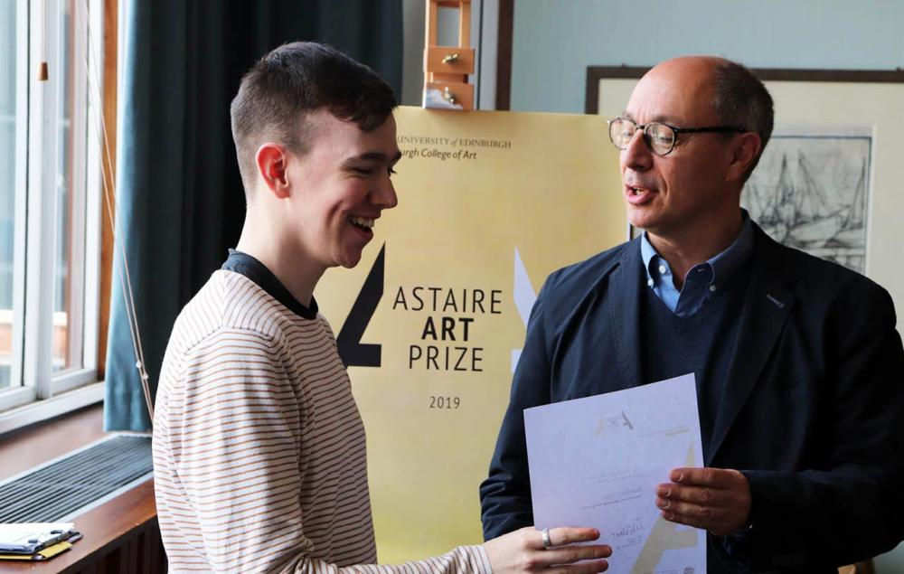 Brandon Logan (L) collecting the prize from Mark Astaire (R)