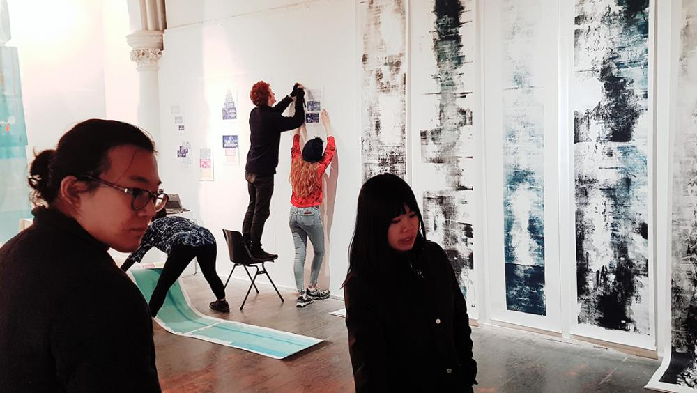 Photograph of students busy installing work for the exhibition