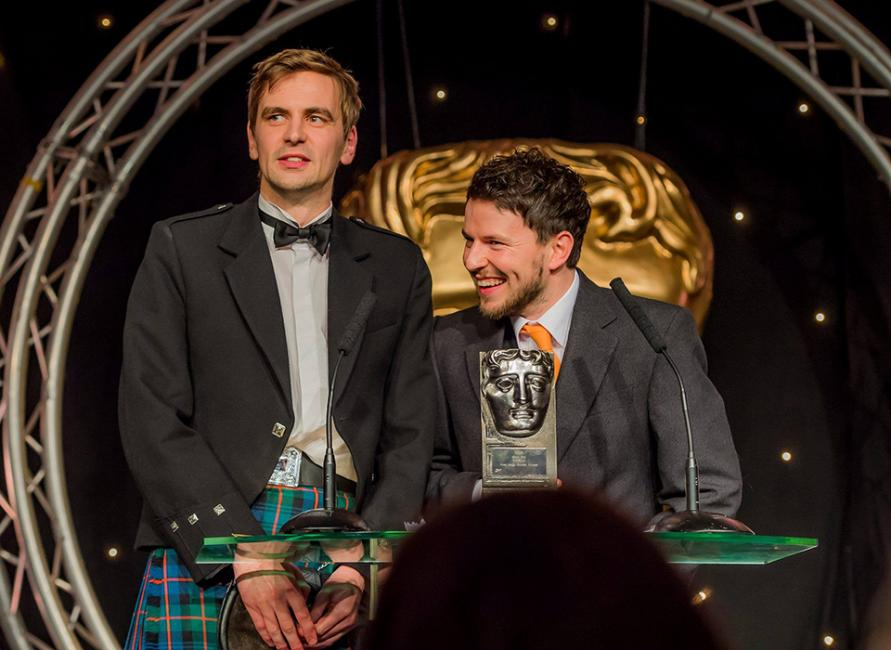 Duncan Cowles and Ross Hogg receiving their BAFTA Scotland Award