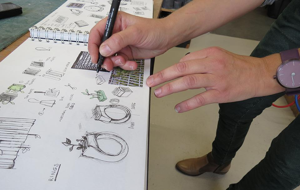 Photo of a student working on a sketch
