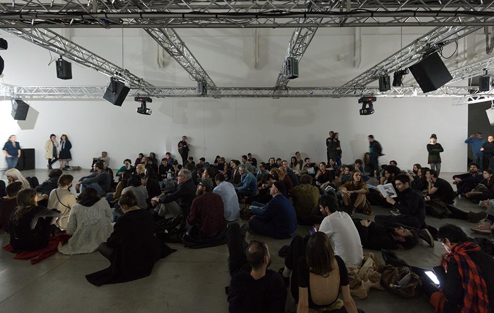 Photo of people listening to a sound installation