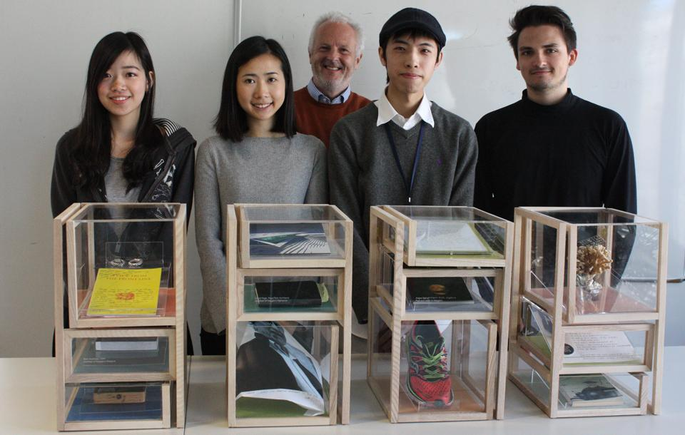 Photo of Interior Design students with an exhibition they designed