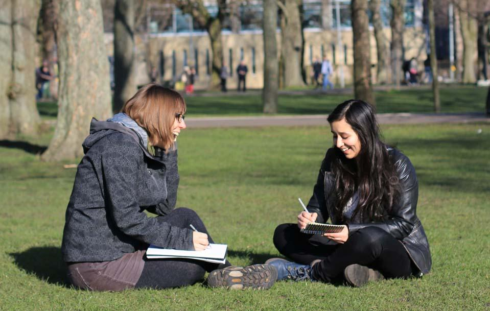 Photo of two students in The Meadows park