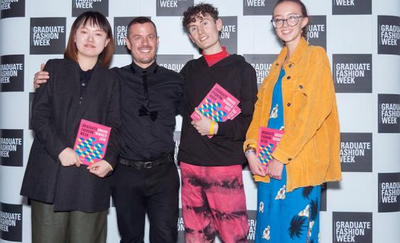 Edinburgh college of Art students and winners at the graduate fashion week awards 2019 proudly show off their awards