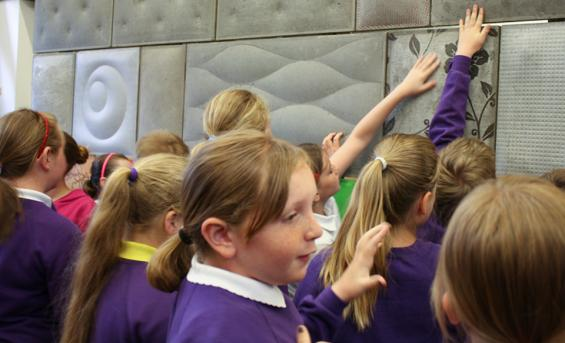 Primary school pupils take part in a concrete workshop